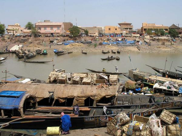 The river town of Mopti and the traditional, lean-hulled river boat called a pinasse
